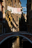 Laundry hanging above a canal in the Dorsoduro area of Venice, Italy