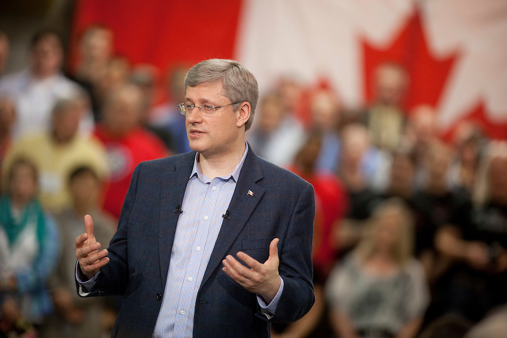 Conservative leader Stephen Harper delivers a speech at a campaign event in Waterloo, Ontario, April 27, 2011. <br /> AFP/GEOFF ROBINS/STR