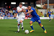AFC Wimbledon defender Darius Charles (32) battles for possession with Northampton Town forward Michael Smith (24) during the EFL Sky Bet League 1 match between AFC Wimbledon and Northampton Town at the Cherry Red Records Stadium, Kingston, England on 11 March 2017. Photo by Matthew Redman.