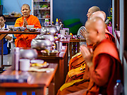 13 JANUARY 2019 - NAKHON PATHOM, THAILAND: Ven. DHAMMANANDA, the Abbess of Wat Songdhammakalyani, leads prayers before breakfast at the temple. The Sangha Supreme Council, Thailand's governing body of Buddhist monks, bans the ordination of female monks, but hundreds of Thai women have gone abroad, mostly to Sri Lanka and India, to be ordained. There are about 270 women monks in Thailand and about 250,000 male monks. There are 7 monks and 6 novices at Wat Songdhammakalyani in Nakhon Pathom. It was the first temple in Thailand to have female monks. The temple opened 60 years ago and has always been a temple of women monks. Women can be ordained as novices in Thailand, but to be ordained as a full monk would require the participation of 10 female monks and 10 male monks, and male monks in Thailand are barred from participating in women's ordination ceremonies.     PHOTO BY JACK KURTZ