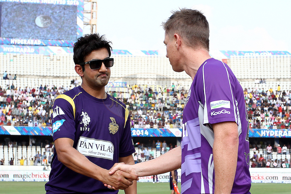 Kolkata Knight Riders captain Gautam Gambhir and Hobart Hurricanes captain Tim Paine shake hands at the toss during the first semi final match of the Oppo Champions League Twenty20 between the Kolkata Knight Riders and the Hobart Hurricanes held at the Rajiv Gandhi Cricket Stadium, Hyderabad, India on the 2nd October 2014<br /> <br /> Photo by:  Shaun Roy / Sportzpics/ CLT20<br /> <br /> <br /> Image use is subject to the terms and conditions as laid out by the BCCI/ CLT20.  The terms and conditions can be downloaded here:<br /> <br /> http://sportzpics.photoshelter.com/gallery/CLT20-Image-Terms-and-Conditions-2014/G0000IfNJn535VPU/C0000QhhKadWcjYs