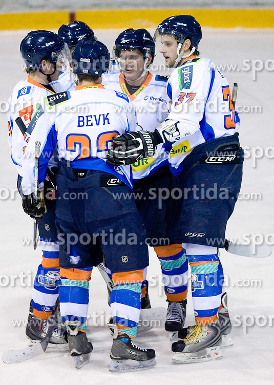 Dejan Zemva, Domen Jemec (R) and Players of Triglav celebrate at SLOHOKEJ league ice hockey match between HK Slavija and HK Triglav Kranj, on February 3, 2010 in Arena Zalog, Ljubljana, Slovenia. Triglaw won 4:1. (Photo by Vid Ponikvar / Sportida)