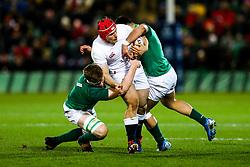 Theo Dan of England U20 is tackled by Sean O'Brien and Dan Kelly of Ireland U20 - Rogan/JMP - 21/02/2020 - Franklin's Gardens - Northampton, England - England U20 v Ireland U20 - Under 20 Six Nations.