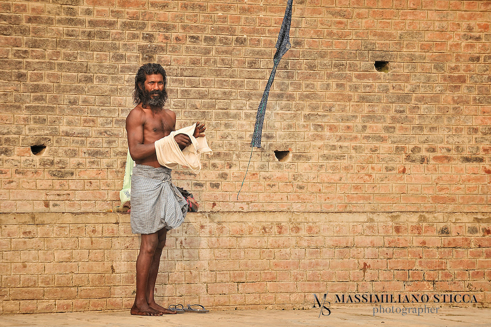 Pilgrim at ghat of Varanasi, after the holy bath.