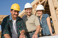 Two men and woman at construction site, portrait