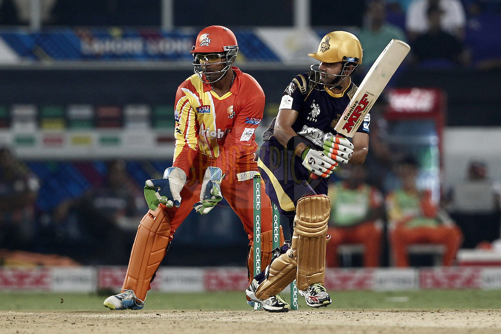 Gautam Gambhir captain of the Kolkata Knight Riders , Umar Akmal of the LAHORE LIONS during match 7 of the Oppo Champions League Twenty20 between the Kolkata Knight Riders and the Lahore Lions held at the Rajiv Gandhi Cricket Stadium, Hyderabad, India on the 21st September 2014<br /> <br /> Photo by:  Deepak Malik / Sportzpics/ CLT20<br /> <br /> <br /> Image use is subject to the terms and conditions as laid out by the BCCI/ CLT20.  The terms and conditions can be downloaded here:<br /> <br /> http://sportzpics.photoshelter.com/gallery/CLT20-Image-Terms-and-Conditions-2014/G0000IfNJn535VPU/C0000QhhKadWcjYs