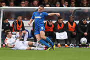 Luton Town defender Glen Rea (16) with a two footed tackle on AFC Wimbledon midfielder Anthony Hartigan (8) during the EFL Sky Bet League 1 match between AFC Wimbledon and Luton Town at the Cherry Red Records Stadium, Kingston, England on 27 October 2018.