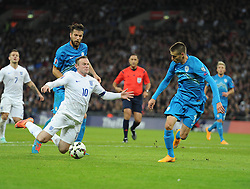 Bostjan Cesar of Slovenia sent Wayne Rooney of England (Manchester United) tumbling in the box. - Photo mandatory by-line: Alex James/JMP - Mobile: 07966 386802 - 15/11/2014 - SPORT - Football - London - Wembley - England v Slovenia - EURO 2016 Qualifier