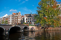Amsterdam, Holland. Wider view of a bridge over a canal.