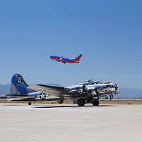 It's sometimes easy to forget how fast and how forward aviation has progressed in a single century - a 4 engined B-17 Flying Fortress - having made the skies safe for everyone in WWII - comes back to parking as a Southwest 757 lifts off. The kicker? These are both Boeing airplanes!