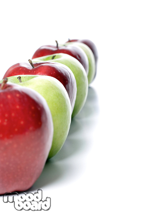 Close up of apples on white background