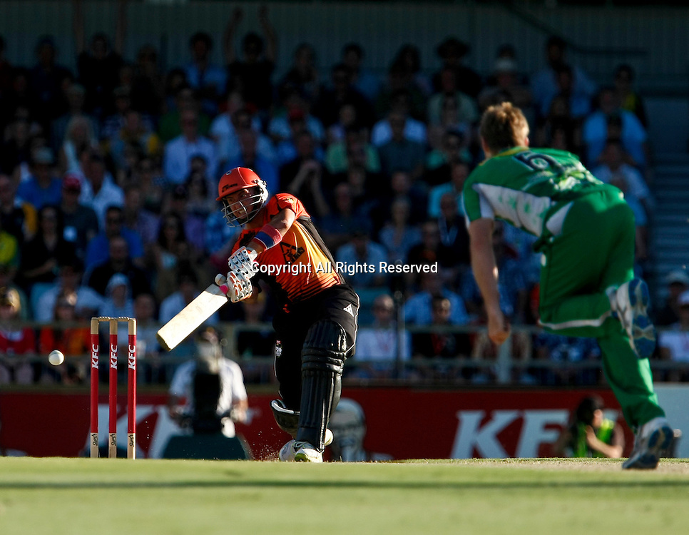 21.01.2012. Perth Australia. Big Bash Cricket.  Hershelle Gibbs hits Luke Wright to the boundary in the Semi Final between the Perth Scorchers and Melbourne Stars.