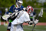 7 MAY 2009 -- CREVE COEUR, Mo. -- St. Louis University High School lacrosse player Michael Leritz (10) battles DeSmet Jesuit High School's Brandon Lenz (18) during the 7th annual Father Marco Cup at DeSmet in Creve Coeur, Mo. Saturday, May 7, 2011. SLUH topped DeSmet 13-10 in the annual game. Image © copyright 2011 Sid Hastings.