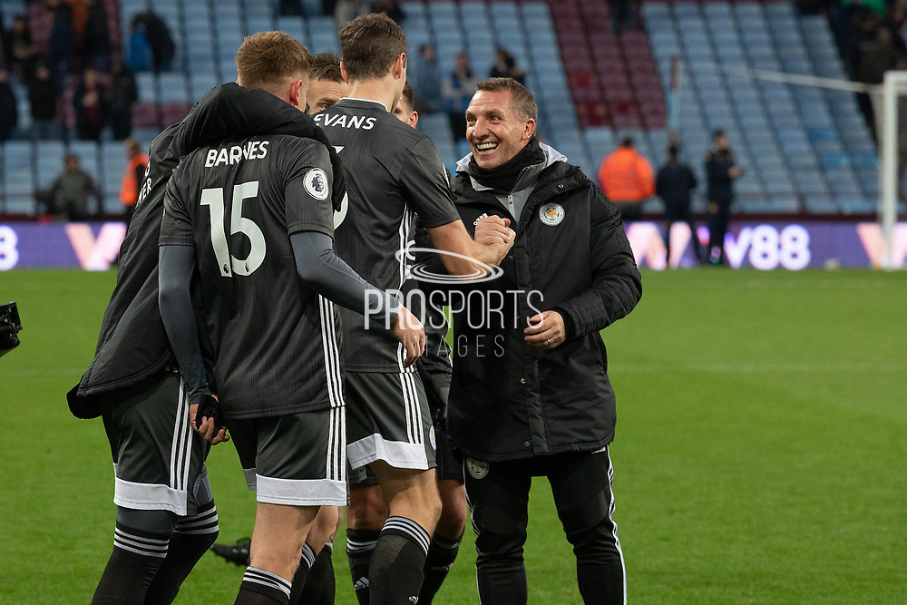 Brendan Rodgers congratulates goalscorer Jonny Evans (6) at the end of  the Premier League match between Aston Villa and Leicester City at Villa Park, Birmingham, England on 8 December 2019.