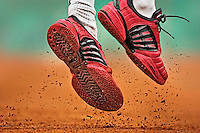 """FRENCH FLY"" or ""RED CARPET""..The red sneakers of Guillermo Coria of Argentina come off the clay during his semi-final match against Tim Henman of Great Britain during the French Open. Coria beat Henman 3-6, 6-4, 6-0, 7-5 but lost to countryman Gaston Gaudio in the finals...French Open Week 2.French Open .Paris, France 06/04/04.Credit: Bob Martin.SetNumber: X70919 TK5"