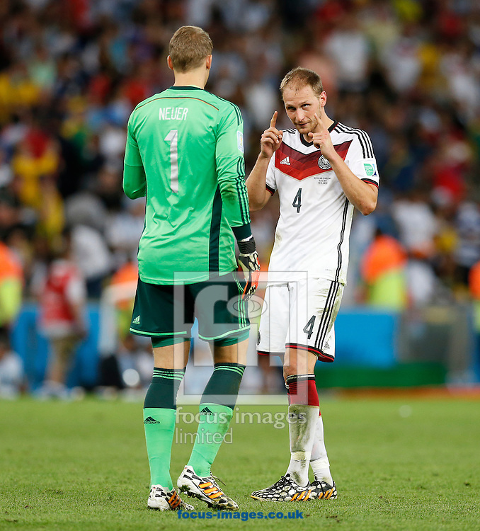 Germany's Manuel Neuer gets a word from Benedikt Howedes during the 2014 FIFA World Cup Final match at Maracana Stadium, Rio de Janeiro<br /> Picture by Andrew Tobin/Focus Images Ltd +44 7710 761829<br /> 13/07/2014