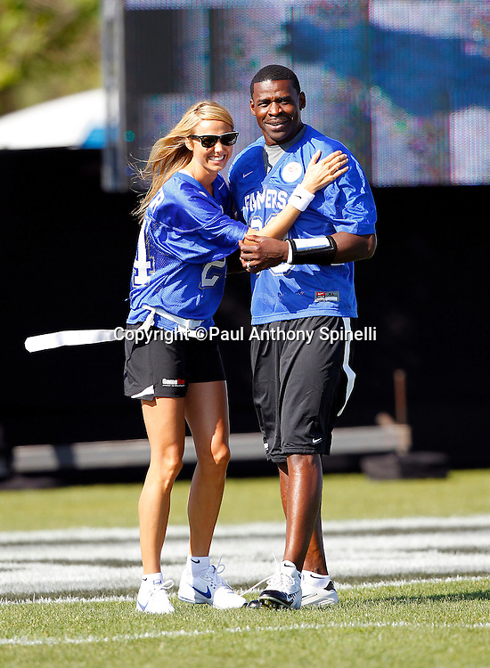 Former Dallas Cowboys wide receiver Michael Irvin (88) of the Famers team lends moral support to actress and teammate Stacy Keibler (24) as they play flag football in the EA Sports Madden NFL 11 Launch celebrity and NFL player flag football game held at Malibu Bluffs State Park on July 22, 2010 in Malibu, California. (©Paul Anthony Spinelli)