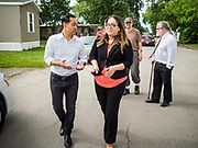 14 JUNE 2019 - WAUKEE, IOWA: JULIÁN CASTRO, Democratic presidential candidate and former Secretary of Housing and Urban Development during the Obama administration, talks to DANIELA FRANCO, a resident of Mobile County Estate, a mobile home community in Waukee, a suburb of Des Moines, Friday. Castro met with residents of the community to talk about affordable housing. Mobile County Estates was sold in March and the new owners are trying to hike rents for lots in the community by 69%, an amount residents say they can't afford. Castro is visiting Iowa to support his candidacy for the Democratic ticket of the US Presidency. Iowa traditionally hosts the the first selection event of the presidential election cycle. The Iowa Caucuses will be on Feb. 3, 2020.                                 PHOTO BY JACK KURTZ