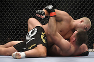 "LONDON, ENGLAND, JUNE 7, 2008: Eddie Sanchez (top) pins Antoni Hardonk to the canvas during ""UFC 85: Bedlam"" inside the O2 Arena in Greenwich, London on June 7, 2008."