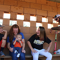 RAY VAN DUSEN/BUY AT PHOTOS.MONROECOUNTYJOURNAL.COM<br /> From left, Cooper; Allison, holding Carter; Audri; and Patrick Swan laugh at a joke Audri just told in a dugout at the Pea Patch. Patrick gave up his drug habit eight years ago and credits the love for his family as his motivation.
