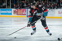 KELOWNA, CANADA - OCTOBER 19: Ryan Olsen #27 of the Kelowna Rockets moves the puck up the ice against the Prince George Cougars on October 19, 2013 at Prospera Place in Kelowna, British Columbia, Canada.   (Photo by Marissa Baecker/Shoot the Breeze)  ***  Local Caption  ***
