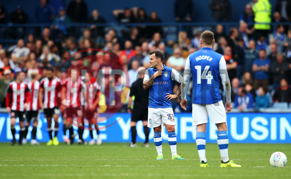 Sheffield Wednesday players look dejected as Sheffield United players celebrate after the fourth goal - Mandatory by-line:  Matt McNulty/JMP - 24/09/2017 - FOOTBALL - Hillsborough - Sheffield, England - Sheffield Wednesday v Sheffield United - Sky Bet Championship