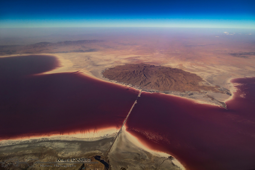 Salty lake Urmia in Iran turned red in 2016 due to the devellopment of an algae as the water got saltier,due to the evaporating water.