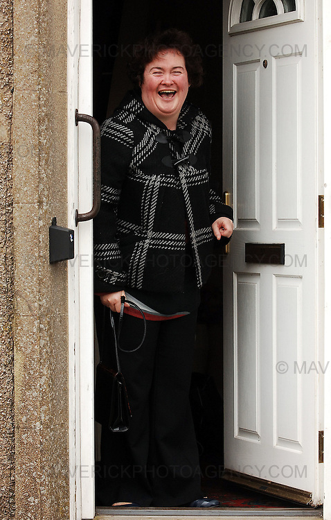 After becoming an overnight  sensation on Britain's Got Talent, the media interest continues on Susan Boyle...Pic shows Susan Boyle leaving her home and having a laugh with the photographers outside her home in Blackburn this morning Monday 4th May 2009.