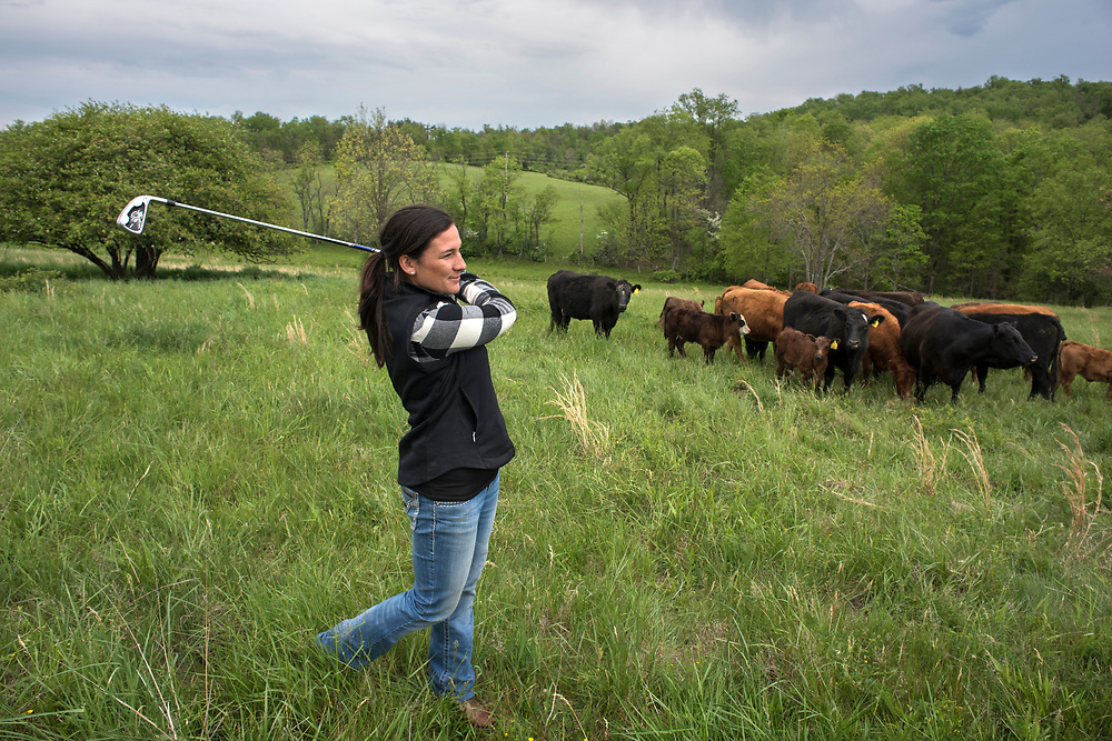 Jefferson Township, PA, May 4, 2017:  Pro golfer Rachel Rohanna with beef cattle she and her husband raise in Greene County, PA. ( Martha Rial for espnW)