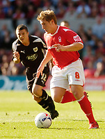 Photo: Leigh Quinnell.<br /> Nottingham Forest v Bristol City. Coca Cola League 1. 21/10/2006. Forests Kris Commons gets away from Bristol Citys Scott Brown.