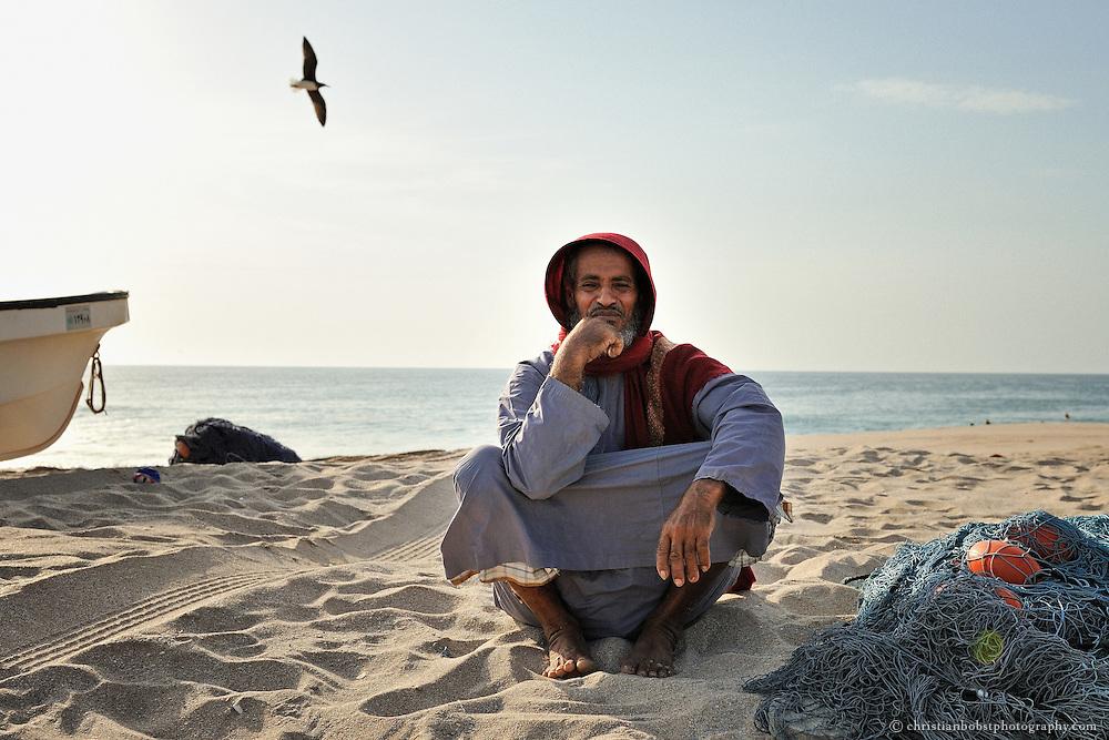 Fisherman at the beach in Ras al Hadd, Oman, 2011