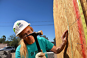 "Sherry Tilton works off 200 hours of ""sweat equity"" at the Amphi construction site toward home ownership through Habitat for Humanity.  Tilton and her 28-year-old daughter will move from an apartment complex to their home in 2020.  Credit: Norma Jean Gargasz"
