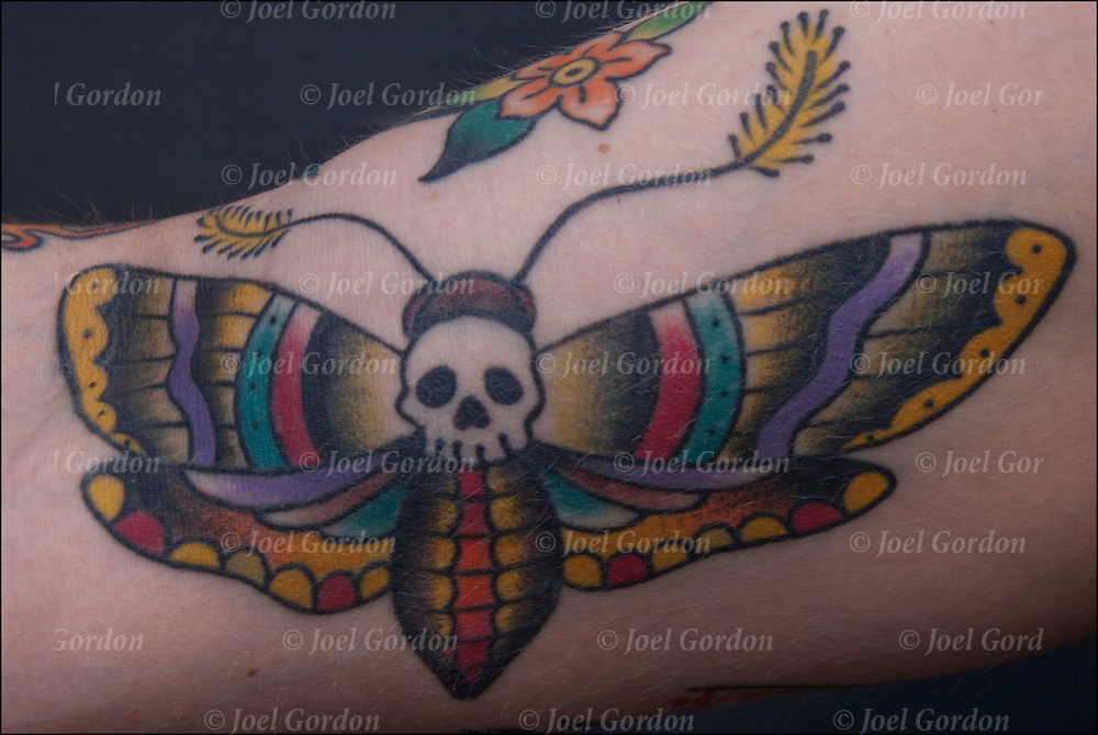 Tattoo of butterfly with skull head an example of Dark Art, Grim, Macabre or Demonic tattoos.<br /> <br /> Body art or tattoos has entered the mainstream it is known longer considered a weird kind of subculture.<br /> <br /> &quot;According to a 2006 Pew survey, 40% of Americans between the ages of 26 and 40 have been tattooed&quot;.