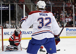 Dec 16, 2009; Newark, NJ, USA; Montreal Canadiens left wing Travis Moen (32) celebrates after scoring on New Jersey Devils goalie Martin Brodeur (30) during the first period at the Prudential Center.