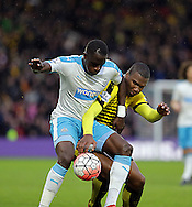 Watford's Obbi Oulare tackles from behind during the The FA Cup Third Round match between Watford and Newcastle United at Vicarage Road, Watford, England on 9 January 2016. Photo by Dave Peters.