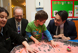 (L-R) Labour candidate John O'Farrell joined Stephen Twigg MP, Labour's Shadow Education Secretary to visit The Little Acorns Day Nursery, Eastleigh, UK, 21 February, 2013. Photo by: i-Images