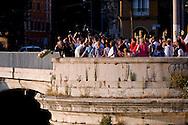 """Roma 25 Luglio 2015<br /> Le Confraternite della Corsica, della Diocesi di Ajaccio, con una cerimonia religiosa nella chiesa di S. Crisogono a Trastevere  hanno onorato la Madonna de Noantri, trovata da alcuni pescatori corsi nel 1535 alla foce del Tevere, e ricordato la Guardia còrsa papale, che nell'anno 1603,  il papa Clemente VIII arruolò in Corsica 600 fanti,  con funzioni di guardia del pontefice e di milizia urbana a Roma. I corsi si concentrarono sull'isola Tiberina e in Trastevere, dove la chiesa di San Crisogono fu """"titolo nazionale"""" e basilica cimiteriale dei còrsi. Don Matteo Zuppi, vescovo ausiliare lancia i fiori nel Tevere in onore della Madonna del Carmine in rappresentanza delle confraternite.<br /> Rome 25 July 2015<br /> The brotherhoods of Corsica, the Diocese of Ajaccio, with a religious ceremony in the church of S. Crisogono in Trastevere have honored Our Lady Noantri, found by some fishermen courses in 1535 at the mouth of the Tiber, and recalled the Corsican Guard  was a military unit of the Papal States composed exclusively of Corsican mercenaries on duty in Rome, having the functions of an urban militia and guard for the Pope.The Corsican Guard was formally founded in 1603 under Pope Clement VIII. The courses of 16th century, they concentrated on Tiber Island and in the part of Trastevere lying between the harbour of Ripa Grande and the church of San Crisogono San Crisogono became the national church and cemetery basilica of the Corsican nation in Rome, and over the centuries was used as burial place of several Corsican military officers. Don Matteo Zuppi, auxiliary bishop throws flowers into the Tiber in honor of the Madonna del Carmine on behalf of the brotherhoods."""
