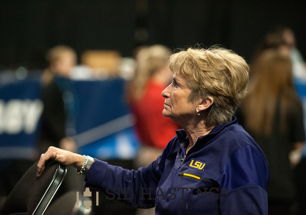 20 APRIL 2018 -- ST. LOUIS -- LSU gymnastics coach D-D Breaux watches her team during warmups before the 2018 NCAA Women's Gymnastics Championship Semifinals in St. Louis Friday, April 20, 2018. LSU finished second in the semifinal, joining UCLA and Nebraska in advancing from the first semifinal into the Super Six championship round on Saturday.<br /> <br /> Photo &copy; copyright 2018 Sid Hastings.