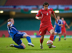 CARDIFF, WALES - Saturday, October 11, 2008: Wales' Gareth Bale is brought down for a penalty by Liechtenstein's Martin Buchel during the 2010 FIFA World Cup South Africa Qualifying Group 4 match at the Millennium Stadium. (Photo by Gareth Davies/Propaganda)