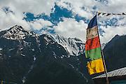 Tibaten flag with the backdrop of the Himalayas at Rakcham
