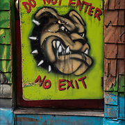 """Sign on store door """"Do Not Enter"""" with picture of bull dog  """" No Exit"""" ."""