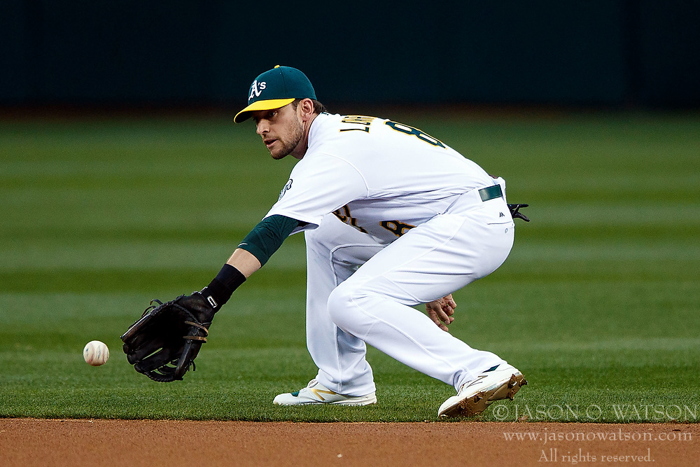 OAKLAND, CA - APRIL 04:  Jed Lowrie #8 of the Oakland Athletics fields a ground ball against the Los Angeles Angels of Anaheim during the first inning at the Oakland Coliseum on April 4, 2017 in Oakland, California. The Los Angeles Angels of Anaheim defeated the Oakland Athletics 7-6. (Photo by Jason O. Watson/Getty Images) *** Local Caption *** Jed Lowrie