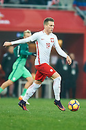 Wroclaw, Poland - 2016 November 14: Piotr Zielinski of Poland controls the ball during Poland v Slovenia - International Friendly Soccer Match at Municipal Stadium on November 14, 2016 in Wroclaw, Poland.<br /> <br /> Adam Nurkiewicz declares that he has no rights to the image of people at the photographs of his authorship.<br /> <br /> Picture also available in RAW (NEF) or TIFF format on special request.<br /> <br /> Any editorial, commercial or promotional use requires written permission from the author of image.<br /> <br /> Mandatory credit:<br /> Photo by © Adam Nurkiewicz / Mediasport