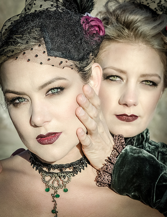Conceptual fashion photographs taken by Janelle Pietrzak aka Explored Exposure of models Sarah Llewellyn and Jennifer Shields, costumes by Lux Muse. Images depict two women on the beach wearing Victorian garments.