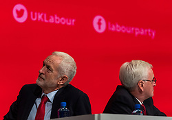 © Licensed to London News Pictures. 24/09/2018. Liverpool, UK. Labour Party Leader Jeremy Corbyn MP (L) and Shadow Chancellor John McDonnell MP (R) on stage at the Labour Party Conference 2018. Photo credit: Rob Pinney/LNP