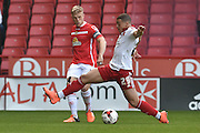Sheffield United forward Che Adams (29) and Harry Davis (4) of Crewe Alexandra  during the Sky Bet League 1 match between Sheffield Utd and Crewe Alexandra at Bramall Lane, Sheffield, England on 25 March 2016. Photo by Ian Lyall.