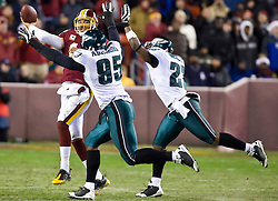 Philadelphia Eagles defensive end Victor Abiamiri (95) and safety Quintin Mikell (27) force Washington Redskins quarterback Jason Campbell (17) to throw the ball away.  The Washington Redskins defeated the Philadelphia Eagles 10-3 in an NFL football game held at Fedex Field in Landover, Maryland on Sunday, December 21, 2008.
