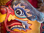 """09 FEBRUARY 2014 - HAT YAI, SONGKHLA, THAILAND: A dragon's face on a pillar in the Chao Mae Tubtim Shrine (Ruby Goddess Shrine) on 108 Hainanese Ancestors Memorial Day in Hat Yai, Songkhla, Thailand. Hainanese communities around the world celebrate """"108 Hainanese Ancestors Memorial Day."""" The day honors the time when 109 Hainanese villagers fleeing life in Hainan (an island off of the southwest coast of China, near Vietnam) washed up in what is now Vietnam and were killed by Vietnamese authorities because authorities thought they were pirates. The Vietnamese built a temple on the site and named it """"Zhao Yin Ying Lie."""" Many Vietnamese fisherman credit prayers at the temple to saving their lives during violent storms and now """"108 Hainanese Ancestors Memorial Day"""" is celebrated in Hainanese communities around the world. Hat Yai, the economic center of southern Thailand has a large Hainanese population.    PHOTO BY JACK KURTZ"""