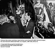 Nicholas Mavroleon smoking a cigar during a party hosted by Billy McCarty-Cooper for Jean Howard's Hollywood book. Los Angeles. 1989. Film.89321/14<br />© Copyright Photograph by Dafydd Jones<br />66 Stockwell Park Rd. London SW9 0DA<br />Tel 0171 733 0108