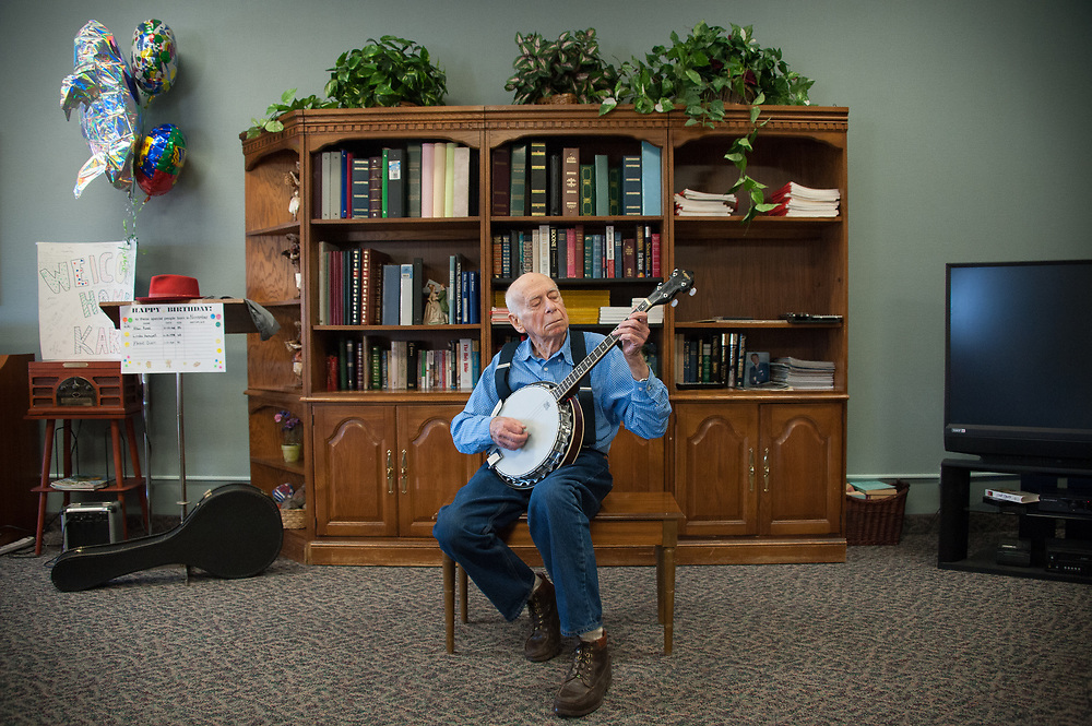 "Bob Martin, ""Banjo Bob"", playing for seniors at assisted living facility"